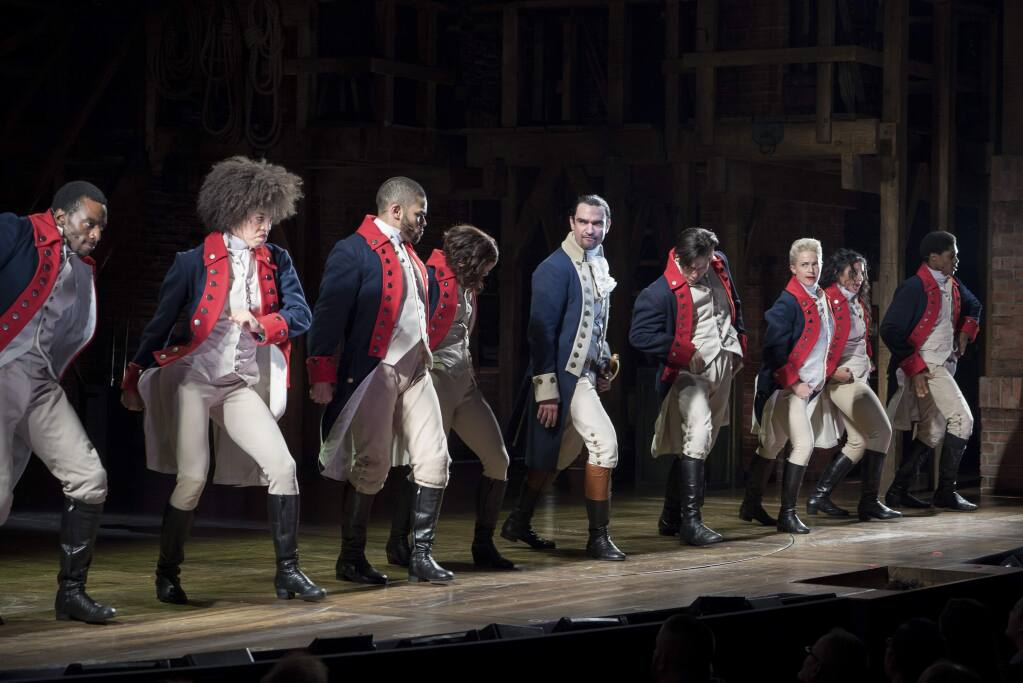 FILE -- Javier Munoz, center, as Alexander Hamilton in the musical ''Hamilton'' at the Richard Rodgers Theater in New York on Nov. 15, 2015. ''Hamilton'' grossed $3.3 million for 8 performances during the 2016 Thanksgiving week, setting a record for the most money ever made in a single week by a Broadway show. (Sara Krulwich/The New York Times)