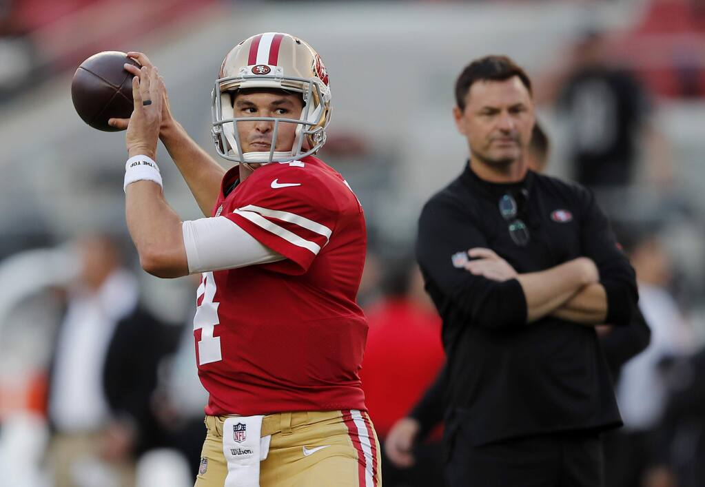 San Francisco 49ers quarterback Nick Mullens, left, warms up in front of assistant coach Rich Scangarello before a game against the Raiders in Santa Clara, Thursday, Nov. 1, 2018. (AP Photo/John Hefti)