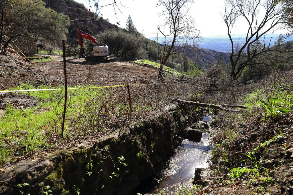 A small creek flows down past a lot that has been cleared of fire debris, off of Cavedale Road, near Glen Ellen on Tuesday, February 13, 2018. (Christopher Chung/ The Press Democrat)