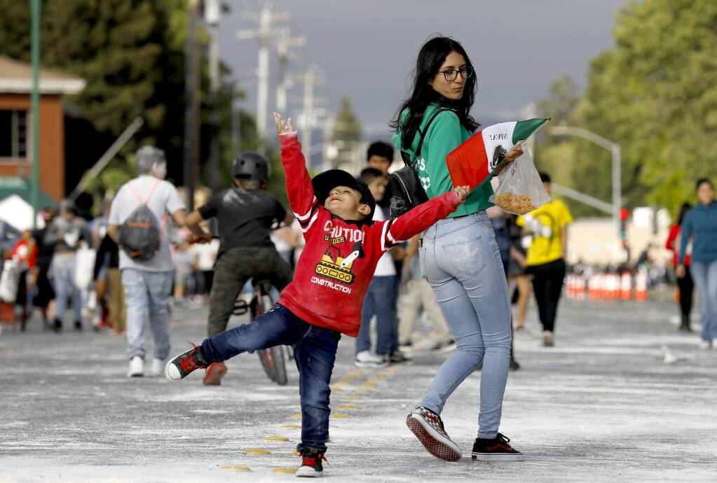 Yamilet Reyes, 17, and her brother Haziel, 3, attend the Cinco de Mayo celebration at the Roseland Village Shopping Center in Santa Rosa on Sunday, May 5, 2019. (Beth Schlanker/The Press Democrat)