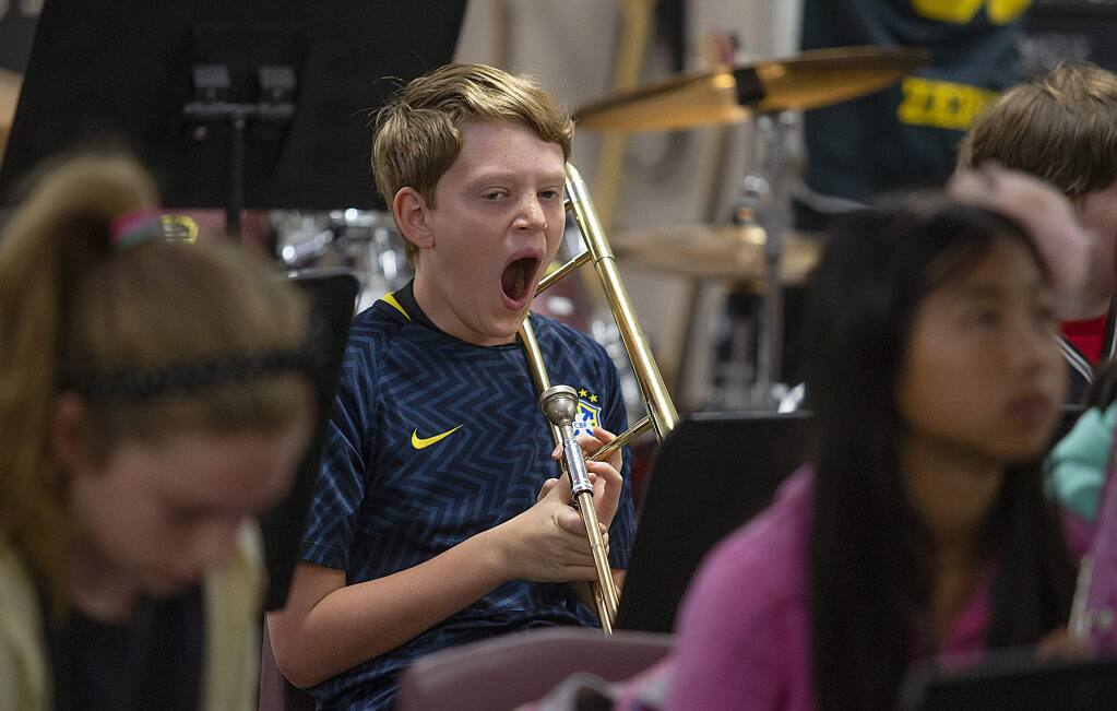After back to school night on Thursday, zero period Jazz band student Liam Limberg, 11, lets out a long yawn just after 7 a.m. during zero period at Lawrence Jones Middle School in Rohnert Park on Friday. A bill on Gov. Jerry Brown's desk would require 8:30 a.m. start times at many middle and high schools in California but would not impose requirements for zero period. (photo by John Burgess/The Press Democrat)
