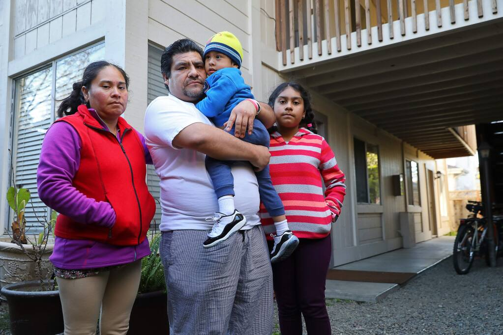 Francisco Arguelles, with his wife Silvia Diaz, and children, Francisco Arguelles Diaz, 3, and America Arguelles Diaz, 10, have been given 90 days to vacate their apartment on Piper Street due to new owners' plans to renovate the property.(Christopher Chung/ The Press Democrat)