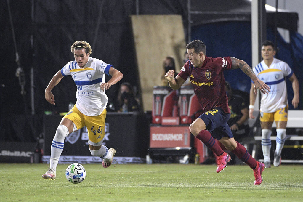 San Jose Earthquakes forward Cade Cowell (44) and Real Salt Lake defender Aaron Herrera (22) compete for a ball during the second half of an MLS soccer match, Monday, July 27, 2020, in Kissimmee, Fla. (AP Photo/Phelan M. Ebenhack)