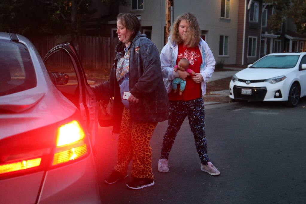 Michelle Petersen and her 19-year-old daughter Jocelyn take an Uber to Jocelyn's doctor's appointment in Santa Rosa on Tuesday, October 23, 2018. (BETH SCHLANKER/ The Press Democrat)