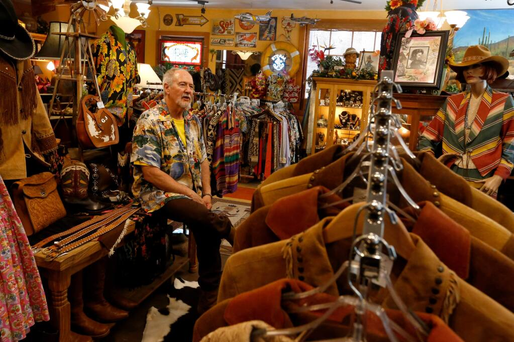 Lonesome Cowboy Ranch frontman Robert Barnhart sits among the variety western, Native American, and Hawaiian clothing and accessories for sale at Lonesome Cowboy Ranch in Boyes Hot Springs, California, on Thursday, June 22, 2017. (Alvin Jornada / The Press Democrat)