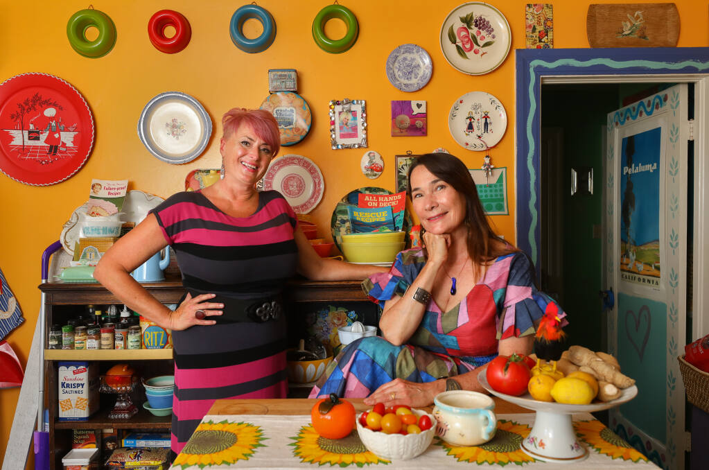 """Becky Madsen de la Rosa, left, and Audrey Marsh wrote the cookbook """"Rescue Recipes: 101 Flexible Recipes for Multiple Diets at the Same Table!,"""" which addresses how to cook for people with different food issues. (Christopher Chung / The Press Democrat)"""