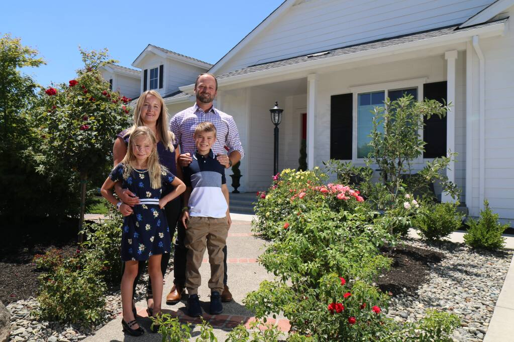 Brandy and Brad Sherwood stand with their children outside their rebuilt Larkfield Estates home in north Santa Rosa on Tuesday, June 2, 2020. Their home was destroyed along with thousands of others by the Tubbs Fire in October 2017. (Jeff Quackenbush / North Bay Business Journal)