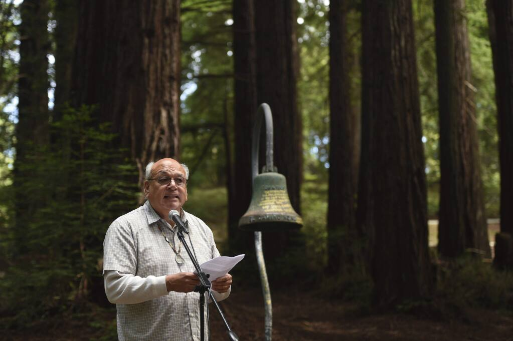 Valentin Lopez, chairman of the Amah Mutsun Tribal Band, speaks in front of an El Camino Real bell marker before it was officially removed from the campus of UC Santa Cruz on Friday, June 21, 2019, in Santa Cruz, Calif. The cast-iron bell marker is one of hundreds in the state which memorializes the California Missions and is viewed by the Amah Mutsun Tribal Band and other California indigenous people as a racist symbol that glorifies the domination of their ancestors. (AP Photo/Cody Glenn)