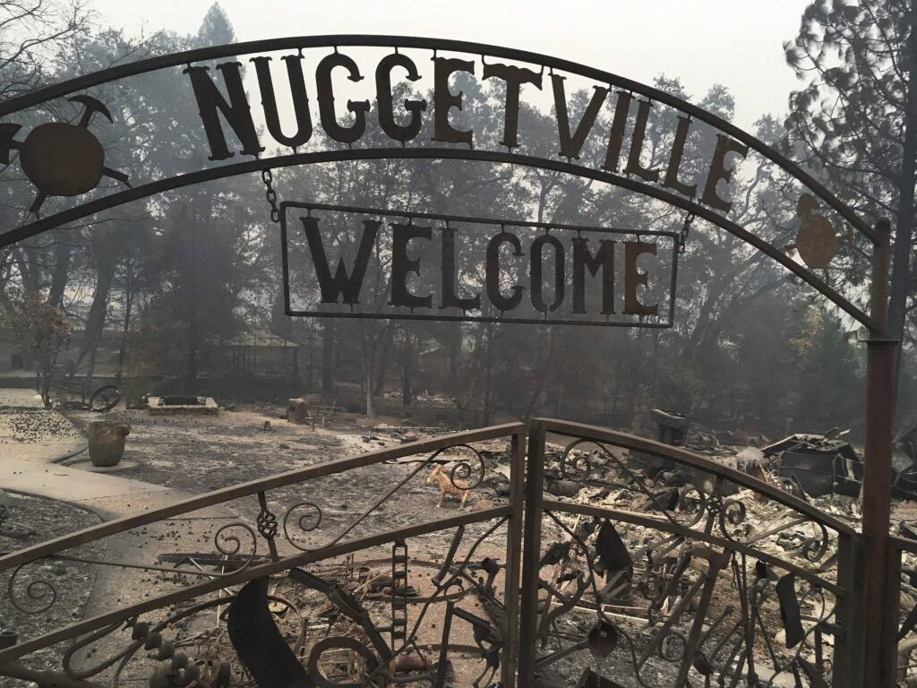 FILE - This Wednesday, Nov. 14, 2018 shows the remains of the Gold Nugget Museum, which was totally demolished by the Camp Fire, in Paradise, Calif. Paradise, Cali., literally went up in smoke in the deadliest, most destructive wildfire in California history. And memories are all that's left for many of the survivors. They recall a friendly place where the pace was relaxed, where families put down roots and visitors opted to stay. (AP Photo/Martha Mendoza, File)