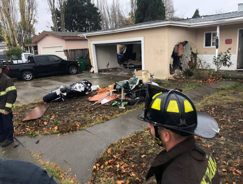A house on Maria Drive in Petaluma was damaged after a car slammed into it, Wednesday, Dec. 4, 2019. (BETH SCHLANKER/ PD)
