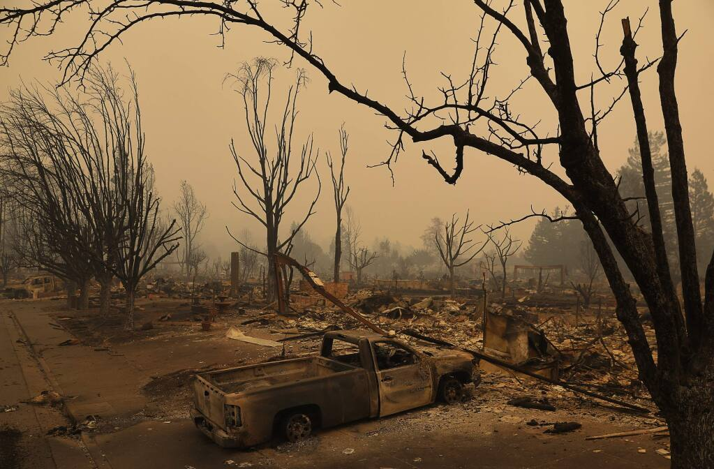 The neighborhood between Mark West Springs Road and Pacific Heights Drive was completely destroyed by the Tubbs Fire, in Santa Rosa on Tuesday, Oct. 10, 2017. (Christopher Chung/ The Press Democrat)