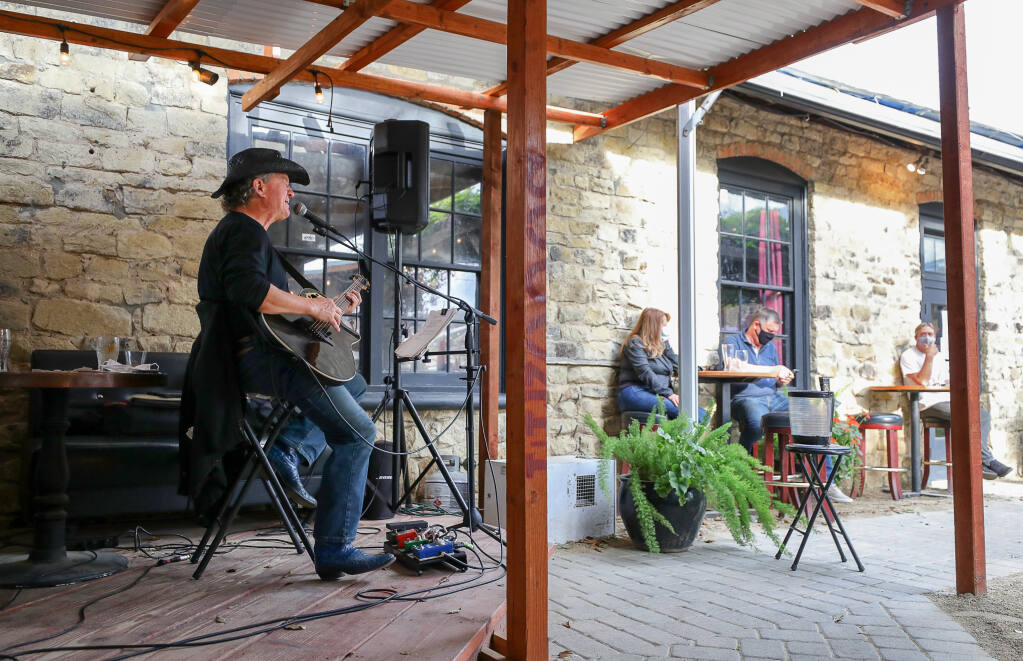 Ricky Ray performs in front of a socially distanced audience in the outdoor beergarden at Hopmonk Tavern in Sebastopol on Wednesday, March 24, 2021.  (Christopher Chung/ The Press Democrat)