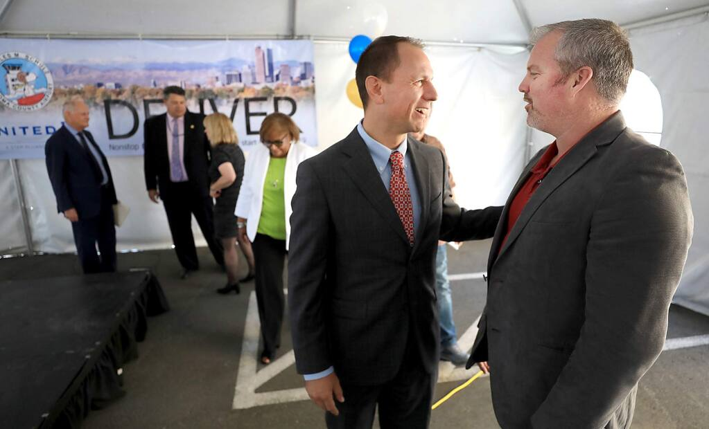 After a press conference announcing United Airlines service from Sonoma County to Denver that will start in 2019, Sonoma County supervisor James Gore, right, and Peter Rumble, CEO of the Santa Rosa Chamber of Commerce greet one another, Monday, August 27, 2018 at the Charles M. Should Sonoma County Airport in Santa Rosa. (Kent Porter / The Press Democrat) 2018