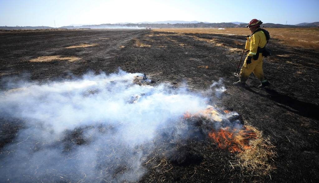 Rancho Adobe fire captain Jimmy Bernal helped to control a large brush fire off Lakeville Highway, Thursday, Oct. 17, 2019. (Kent Porter / The Press Democrat)
