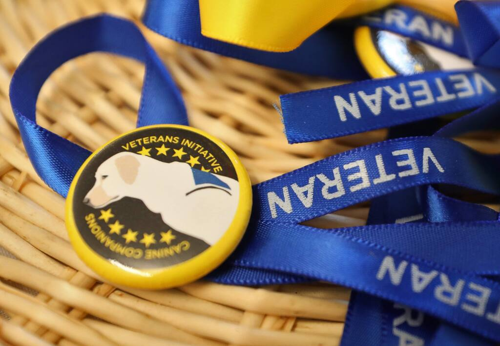 Ribbons for veterans to wear at the Canine Companions for Independence celebration of opening a new training building designed specifically for veterans with post traumatic stress disorder at the campus in Santa Rosa on Tuesday, Dec. 3, 2019. (Christopher Chung/ The Press Democrat)