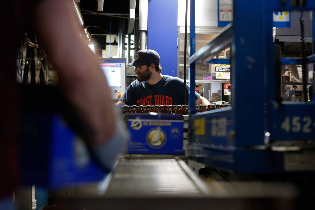 Bottler Jordan ball keeps an eye on the labeling line at North Coast Brewing Co. in Fort Bragg, California, on Thursday, March 10, 2016. (ALVIN JORNADA/ PD)