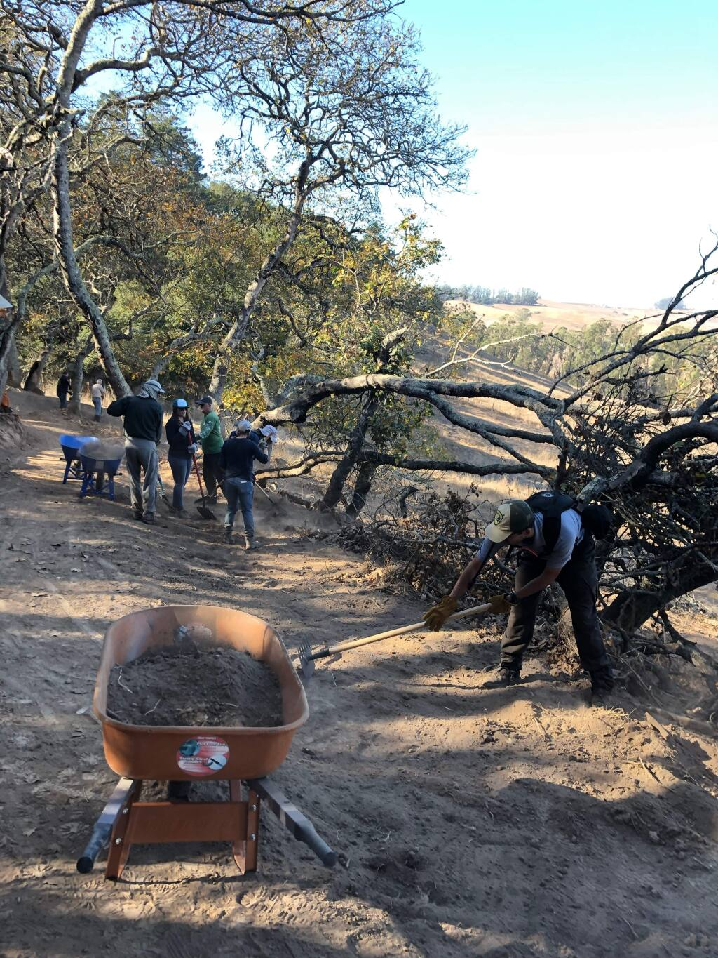 CAROL EBER PHOTOVolunteers work to help prepare one of the four new trails now available at Helen Putnam Park.