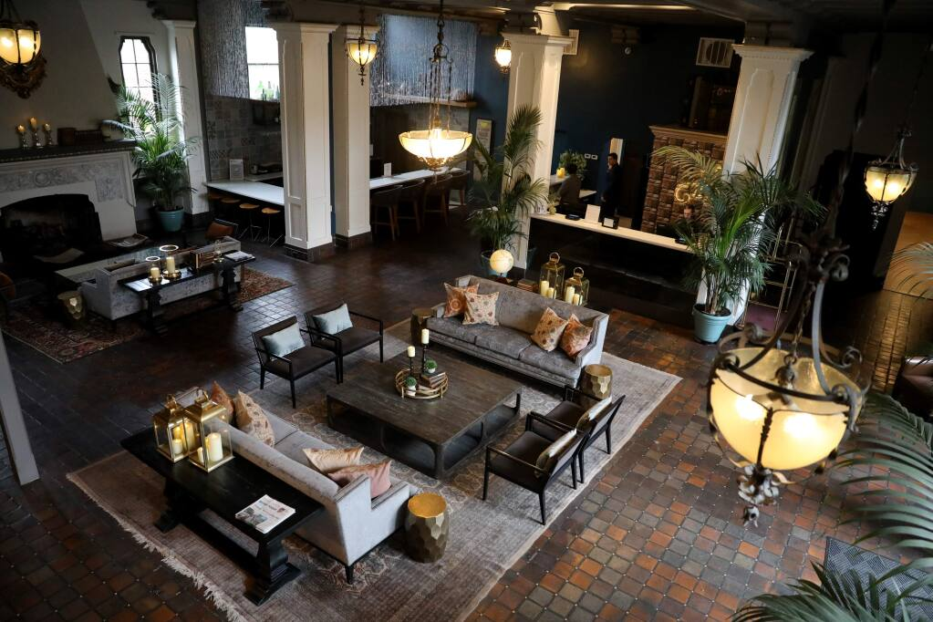 The lobby of the Hotel Petaluma is empty with the exception of front desk staff in Petaluma, California on Wednesday, March 18, 2020. (BETH SCHLANKER/The Press Democrat)