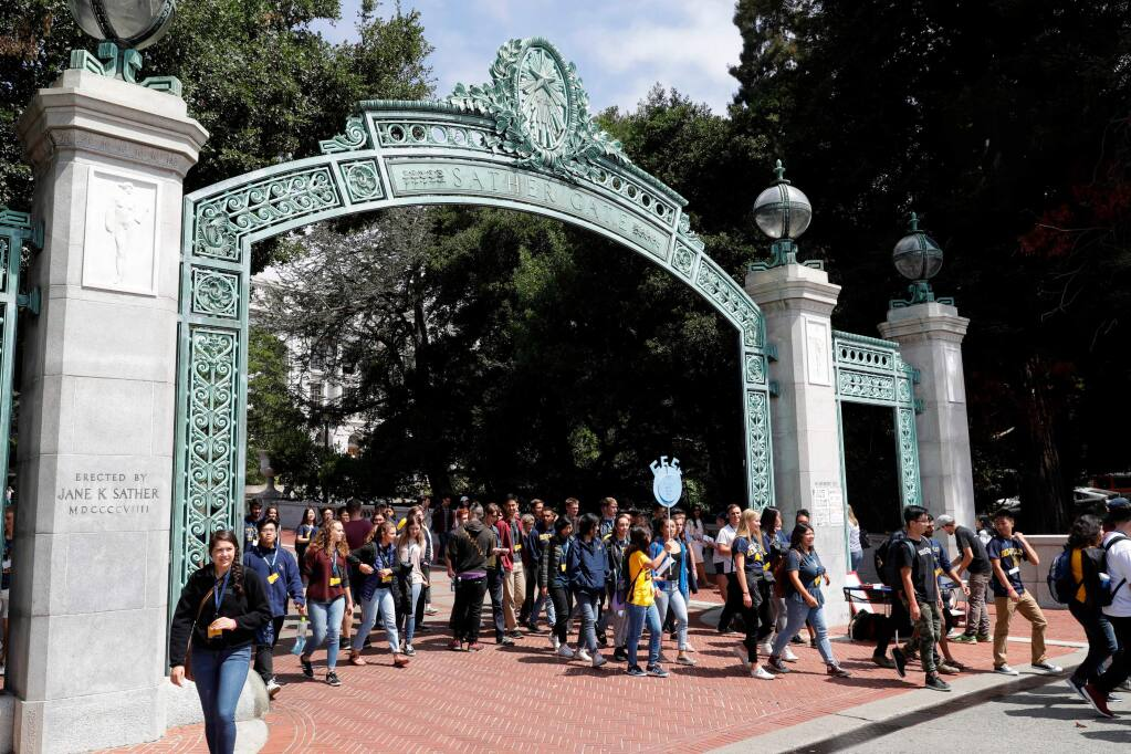 FILE - In this Aug. 15, 2017 file photo, students walk on the University of California, Berkeley campus in Berkeley, Calif. (AP Photo/Marcio Jose Sanchez, File)
