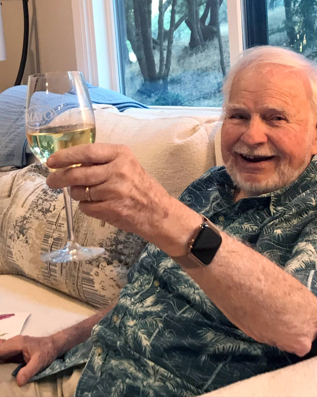Henry Mayo enjoys a glass of his chardonnay at his Bennett Valley home in a recent family photo. Mayo died on Dec. 5, 2020. He was 86. (Submitted)