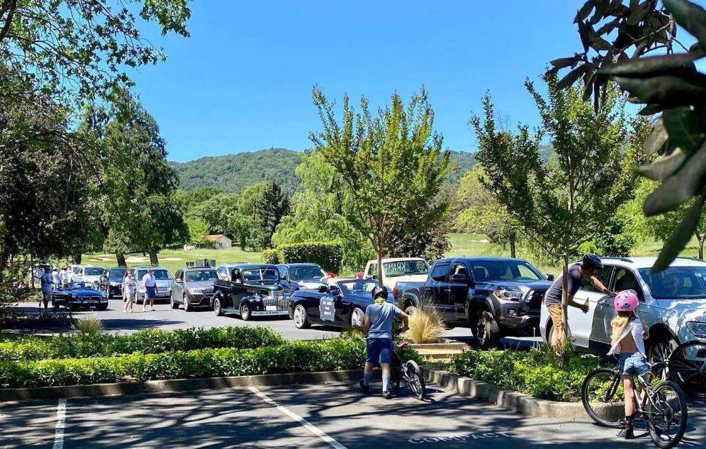 Friends and family stage a socially distant car parade at the Sonoma Golf Club to welcome COVID-19 survivor Jerry Kram home in April of 2020. A new library archive aims to document the story of the pandemic for future generations of Sonomans.