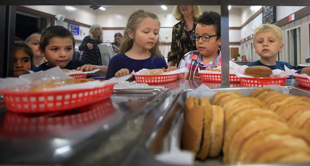 Thomas Page Academy kindergartners line up for a healthy lunch in the school's multi-use room in Cotati, Thursday May 11, 2017. (Kent Porter / The Press Democrat) 2017