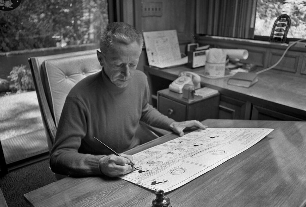 Charles M. Schulz at his drafting table, 1969. (Tom Vano, courtesy of the Charles M. Schulz Museum and Research Center, Santa Rosa)