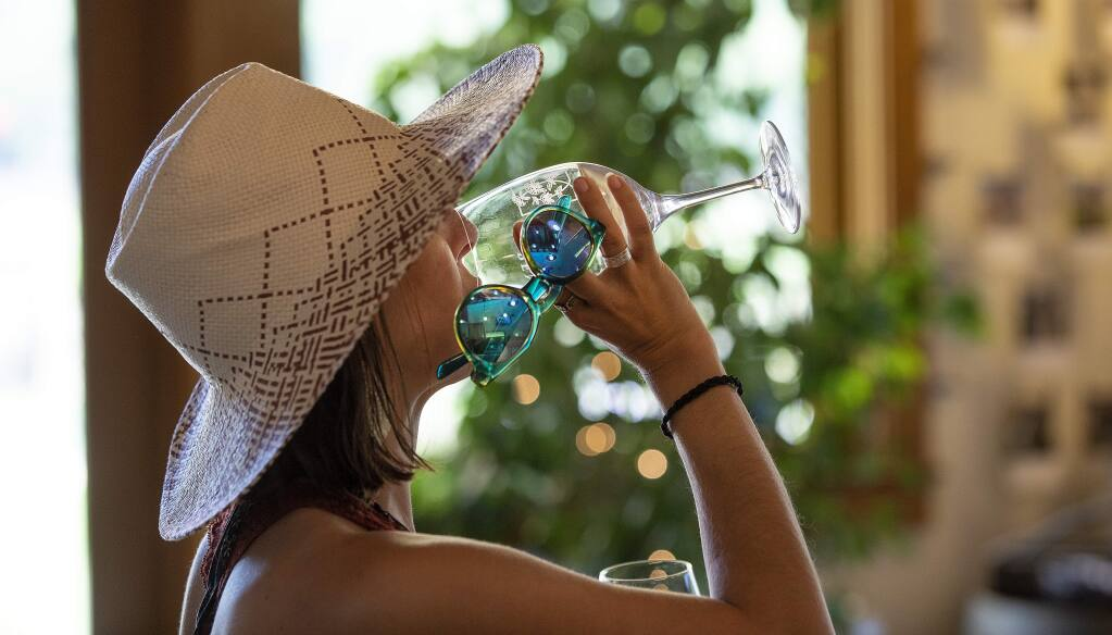Ashley Smith of Aptos finishes a sample of wine during a cheese pairing at Pennyroyal Farm in Boonville in this undated photo. Pennyroyal has opened for wine and cheese tastings on its outdoor patio. (John Burgess/The Press Democrat)