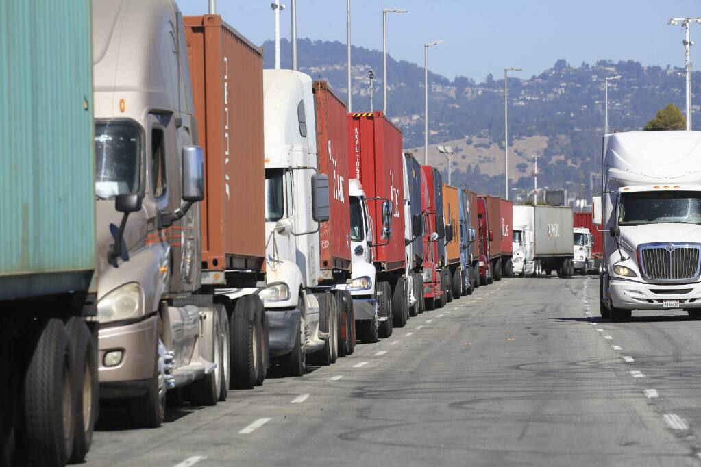 Truckers wait to unload their containers at the Port of Oakland in Oakland, Aug. 30, 2016. (Jim Wilson/The New York Times)
