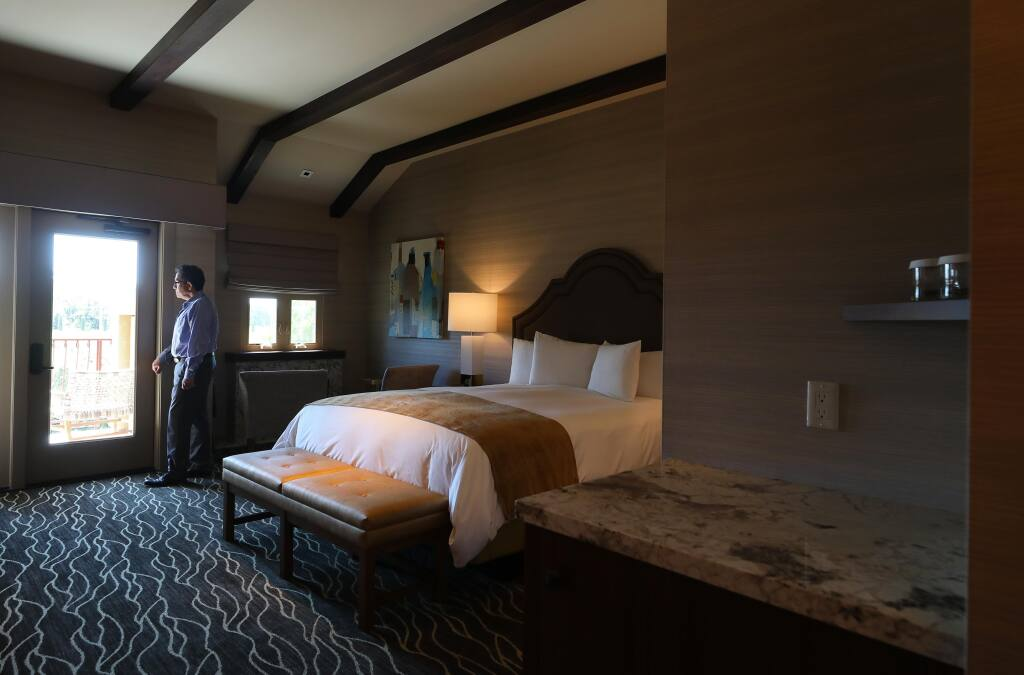 Vintners Resort general manager Percy Brandon stands in a guest room modified to reduce high touch objects for sanitary purposes, in Santa Rosa on Friday, June 26, 2020.  Decorative pillows, coffeemakers, and ice buckets have been removed from rooms, and are provided by bellhops upon request.(Christopher Chung/ The Press Democrat)