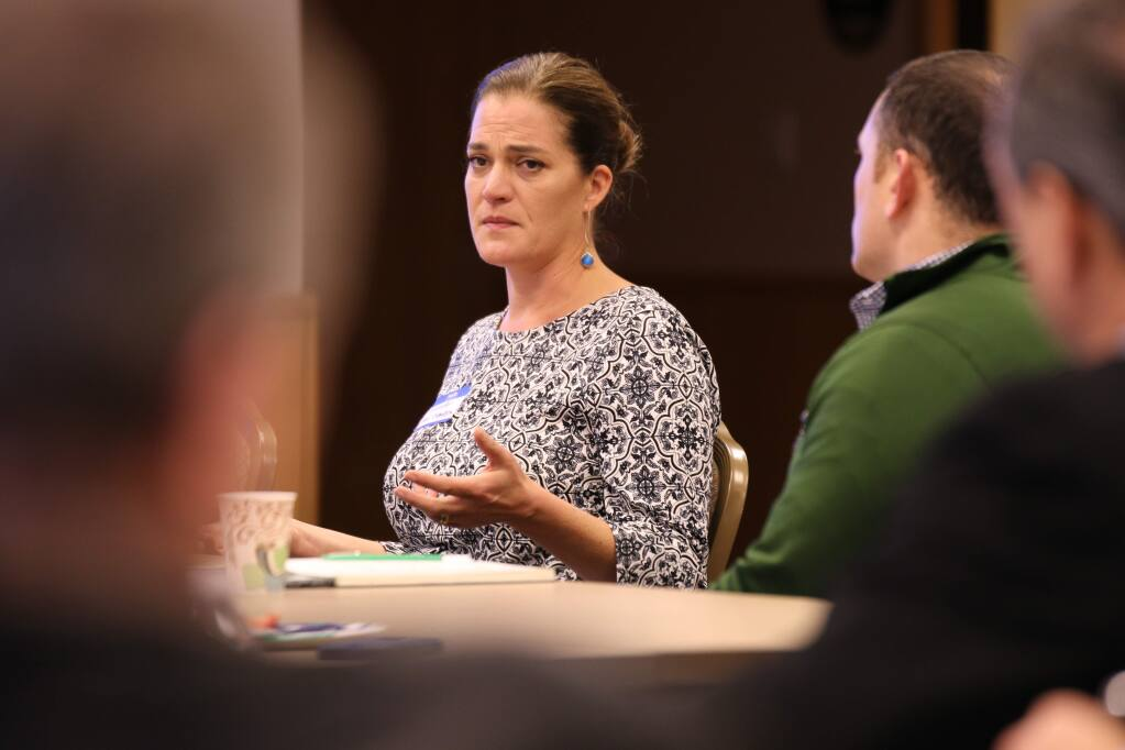 Jennifer Gray Thompson, executive director of Rebuild North Bay Foundation, speaks at a presentation by Lawrence Amaturo at North Coast Builders Exchange's offices in Santa Rosa. (JEFF QUACKENBUSH / NORTH BAY BUSINESS JOURNAL) Jan. 17, 2018