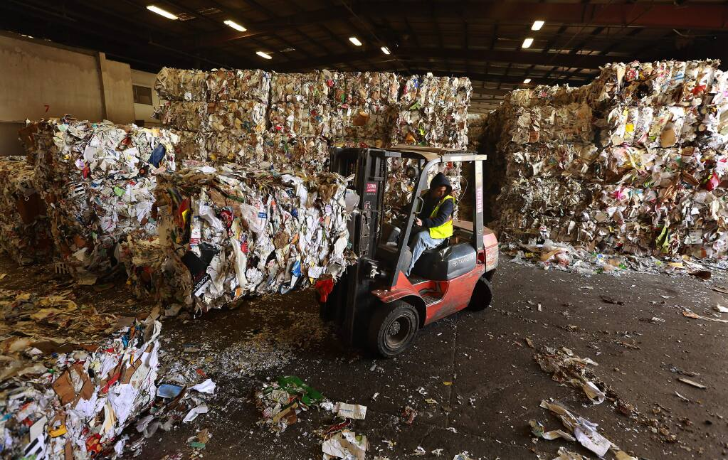 The Redwood Empire Disposal Santa Rosa plant has a 5,000 ton backlog of recycled paper, plastic and metal waiting to be shipped because of a slowdown at the Port of Oakland. (Photo by John Burgess/The Press Democrat)