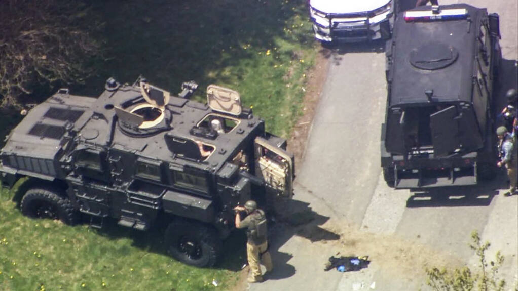 In this image released by WSOCTV Wednesday, April 28, 2021, stage outside a home in Boone N.C., after two deputies were shot. Two deputies were killed and three other people including a suspected gunman were found dead after a lengthy standoff in North Carolina, a sheriff's office said Thursday, April 29, 2021. (WSOCTV via AP)