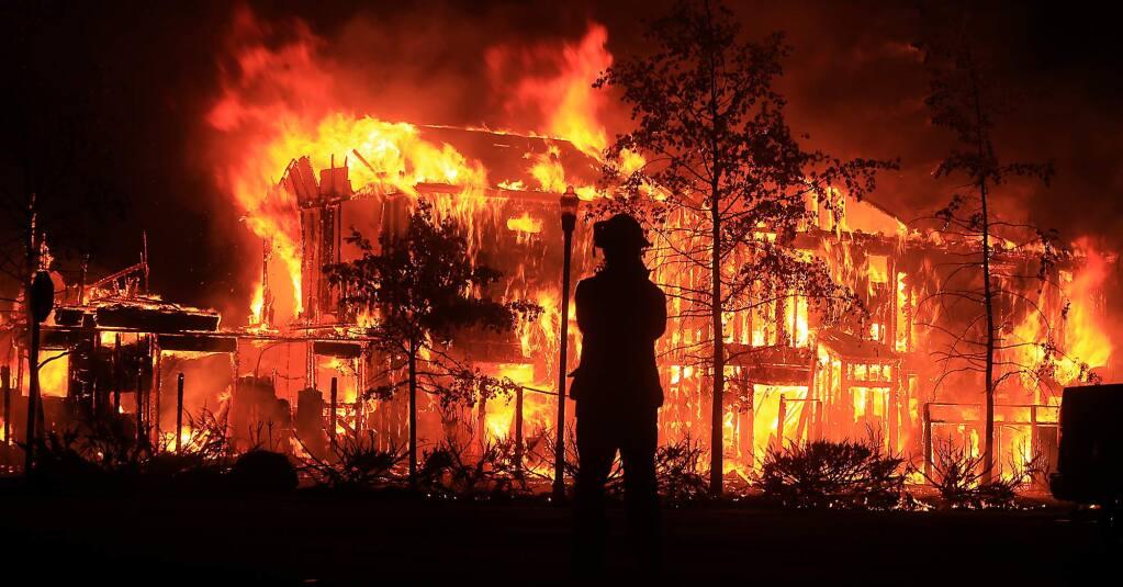 A Middletown apartment complex burns, Sunday Sept. 13. (Kent Porter/Press Democrat)