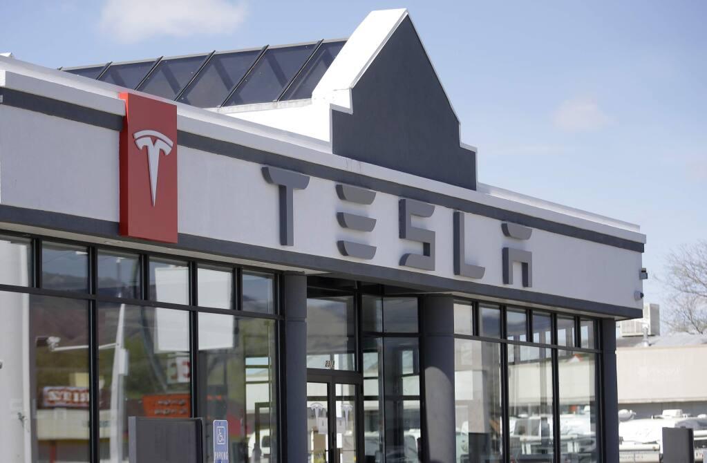 FILE - In this April 1, 2015, file photo, shows the Tesla Motors showroom in Salt Lake City. (AP Photo/Rick Bowmer, File)