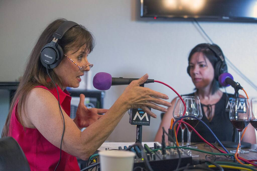 Left, Marcia Macomber, of Cornucopia Creations, with Ruby Fontanta, right, leads a podcast about three Canihan wines from a back room at The Panel on West Napa St. on Thursday, July 25. (Photo by Robbi Pengelly/Index-Tribune)