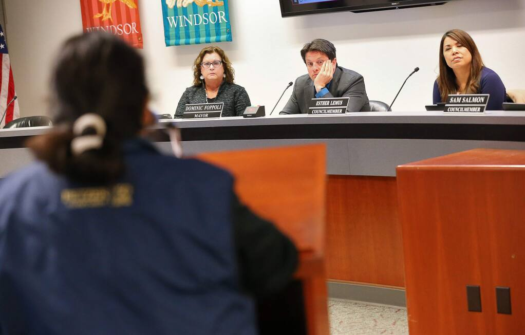 Debora Fudge, left, Dominic Foppoli, and Esther Lemus listen to comments from Rosa Reynoza during a Windsor Town Council meeting addressing voting districts in Windsor on Monday, Feb. 25, 2019. (Christopher Chung / The Press Democrat)