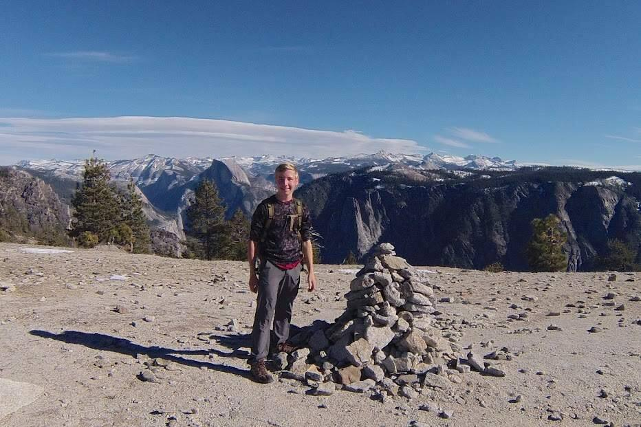 Petaluma 16-year-old Tucker Cullen stands on the rim of Yosemite Valley. He is about to embark on a 220-mile hike of the John Muir Trail to raise money for outdoor education programs. COURTESY TUCKER CULLEN