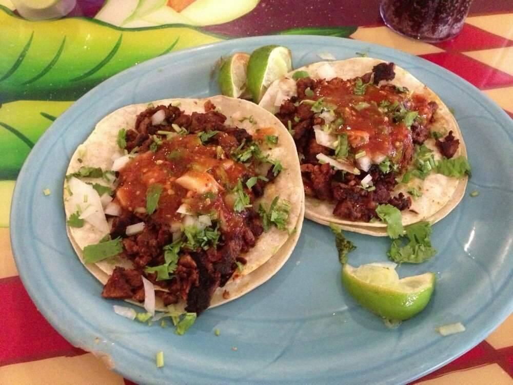Tacos al pastor at Taqueria La Hacienda, closed by fire following a recent kitchen remodel.