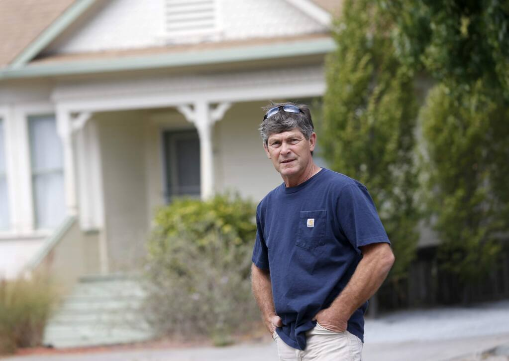 Greg Lichau saved Cindy Spreter from a vicious pit bull attack after he heard her cries from across the street. Photo taken on Monday, Aug. 29, 2016 in Petaluma. (BETH SCHLANKER/ PD)