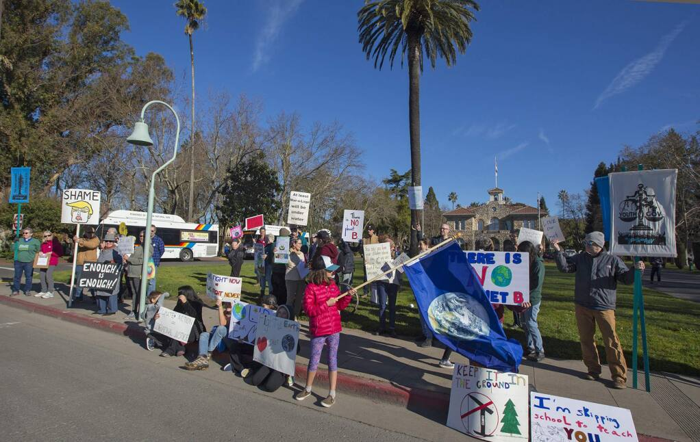 On Sonoma Plaza, Sonomans joined in the worldwide youth 'school strikes' inspired by 15-year-old Swedish activist Greta Thunberg. Demonstrators are mobilizing to protest their governments lack of action in fighting global warming. More school protestors are expected on the Plaza this afternoon. (Photos by Robbi Pengelly/Index-Tribune)