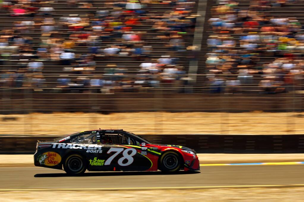 Martin Truex Jr. (78), driving the 5-hour Energy Toyota, accelerates out of Turn 2 during the Monster Energy NASCAR Cup Series Toyota/Save Mart 350 race at Sonoma Raceway, in Sonoma, California, on Sunday, June 24, 2018. Truex would go on to win the race, making his third win this year. (Alvin Jornada / The Press Democrat)