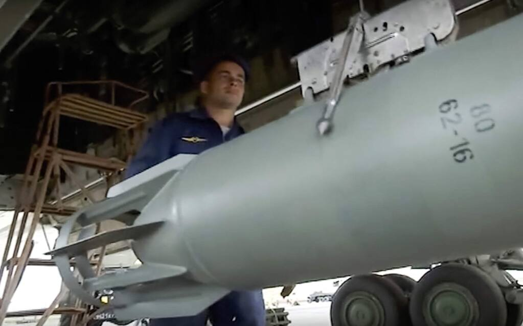 In this frame grab provided by Russian Defence Ministry press service, a technician prepares a Russian long range bomber Tu-22M3 for an an air strike over Syria on Thursday, Aug. 18, 2016, at an undisclosed location. (Russian Defence Ministry Press Service photo via AP)