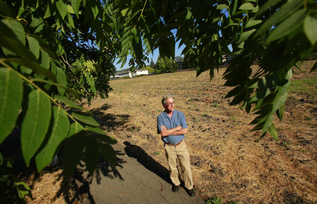 Steve Rabinowitsh stands by the strip of land once envisioned to be used for a freeway overpass that he hopes to now turn into a bike path and park system near Franquette Avenue in Santa Rosa on Thursday, August 21, 2014. (Conner Jay/The Press Democrat)