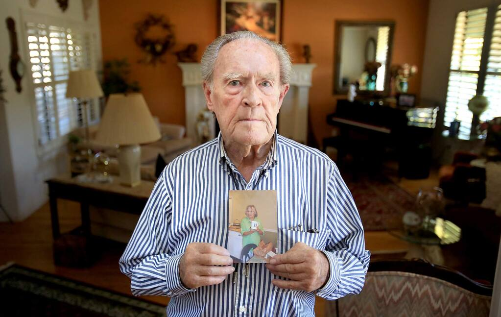 Oakmont resident Denny Ragan, 86, Monday July 27, 2015 with a picture of his wife Barbara who jumped off a Kaiser Permanente parking structure and died. The Ragan family says that Kaiser failed to give her timely and adequate care and was having trouble with her medication. (Kent Porter / Press Democrat) 2015