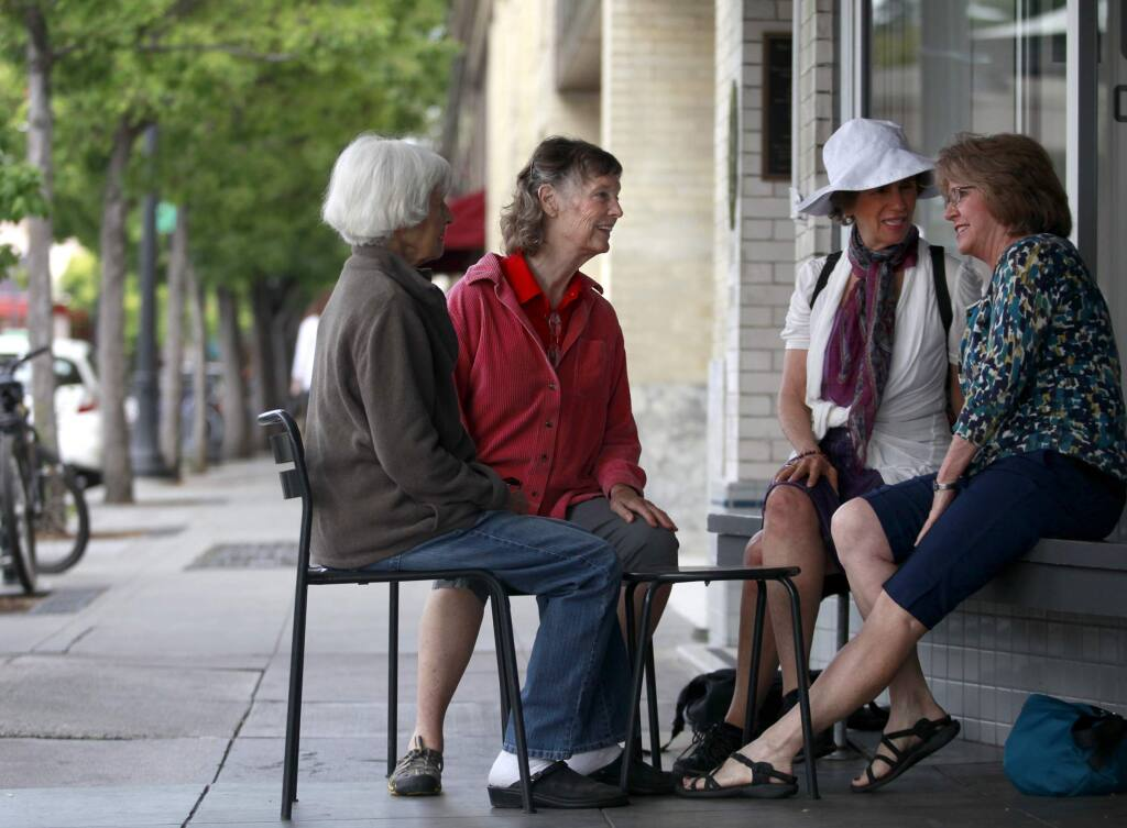 Anne Greenblatt, second from left, of the Village Network, talks with members Nora Pearl, center right, Doris Nelson, right, and prospective member Carolyn Wagenvoord, left, as they meet up in Petaluma on Tuesday, July 15, 2014. (BETH SCHLANKER / The Press Democrat)