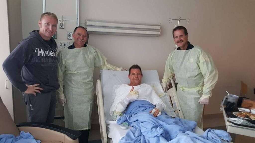 Credit: Cal FireCal Fire firefighter Richard Reiff, center, was in good spirits Monday despire suffering burns while combatting the Valley fire.