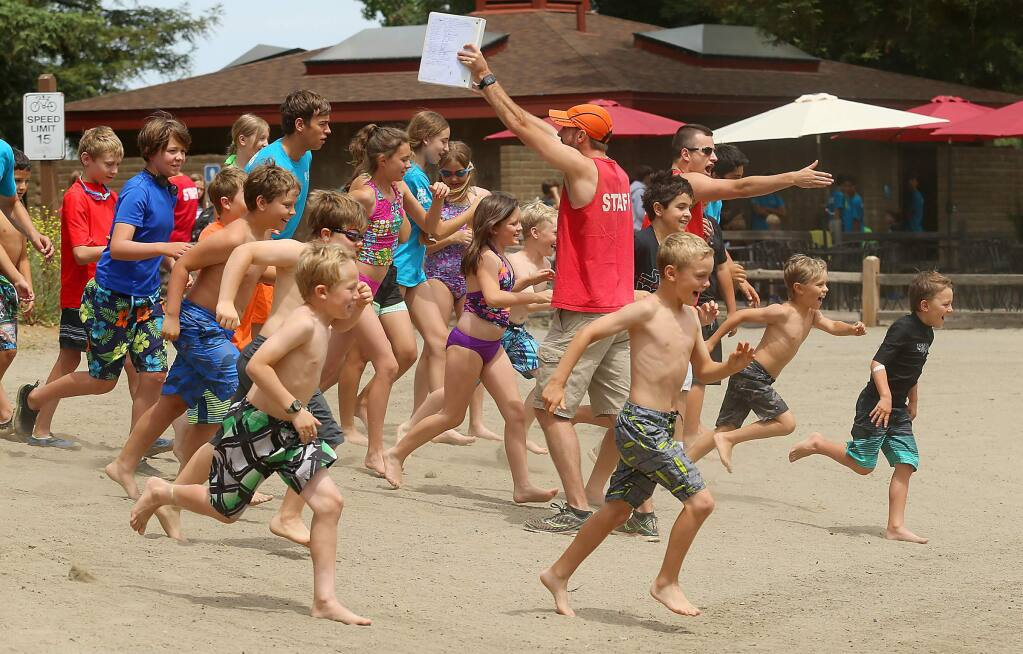 Camp Wa-Tam participants sprint down the beach into the lagoon at Spring Lake in 2017. Santa Rosa Recreation & Parks announced May 4 that summer camps are canceled because of the coronavirus pandemic. JOHN BURGESS/The Press Democrat