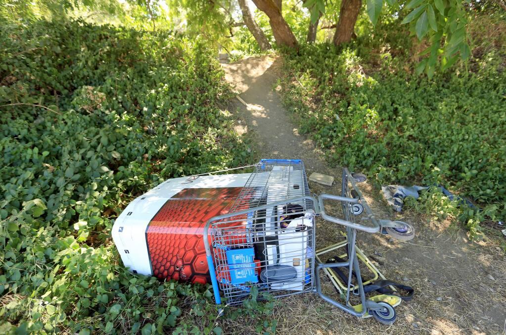 A shopping cart at the entrance to Orr Creek in Ukiah, Thursday July 31, 2014. (Kent Porter / Press Democrat) 2014