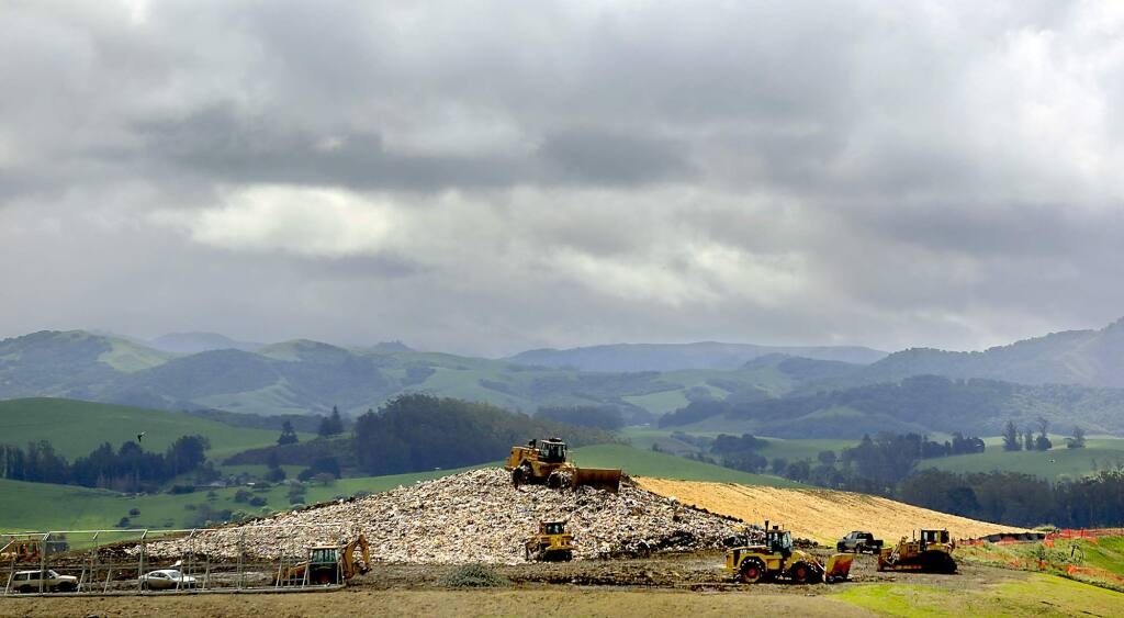 Heavy equipment spreads and compresses garbage at the Sonoma County Landfill in 2013. (KENT PORTER/ PD FILE)